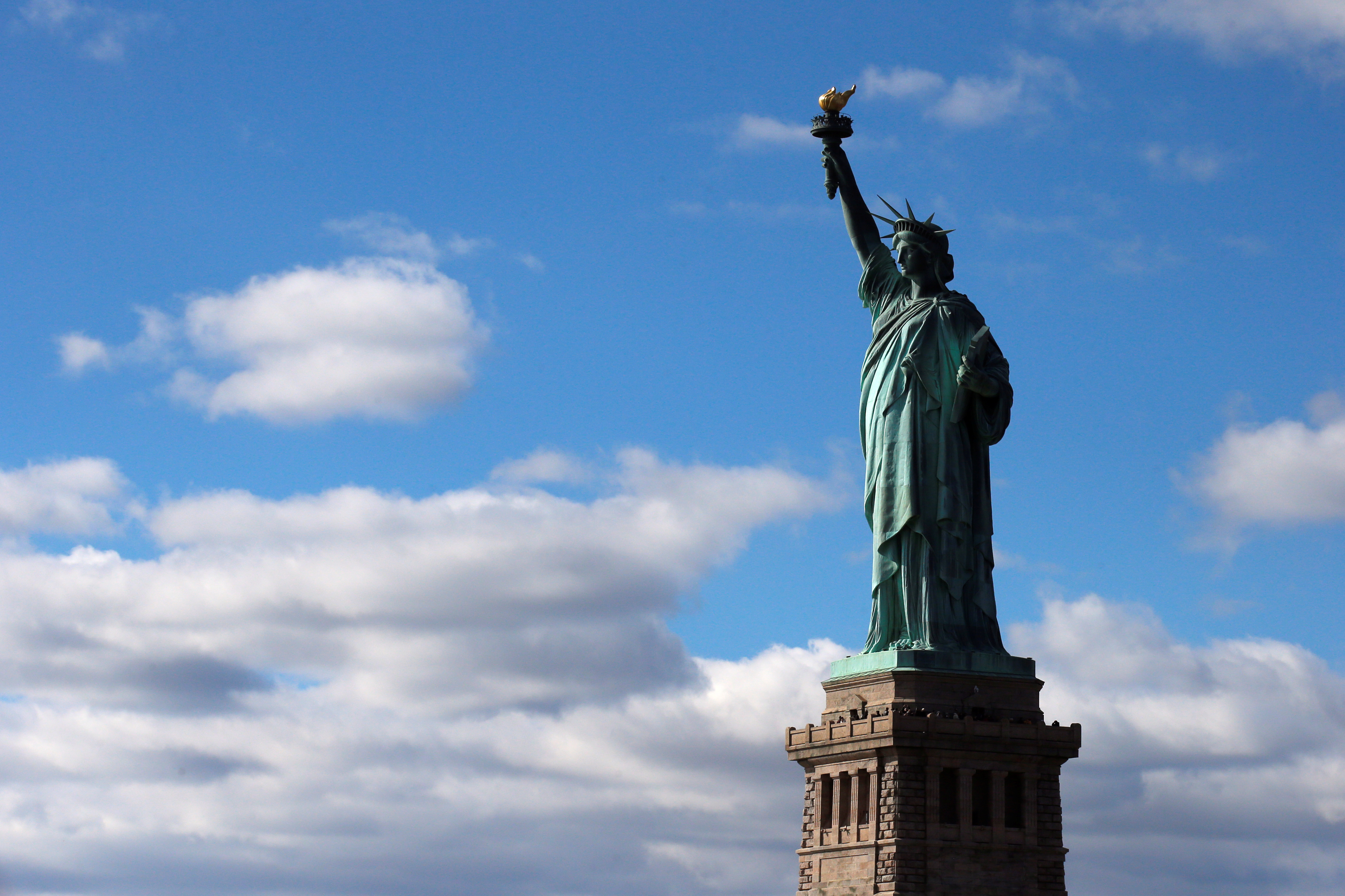 The Statue of Liberty is seen on the 130th anniversary of the dedication in New York Harbor